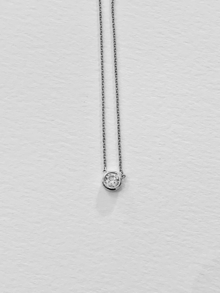This is a very elegant and delicate bezel design necklace,  16 inches in length with the intention for it to be worn close to the neck to give a shimmer of a stone and be constantly on show..   The .50ct Round Brilliant Cut Diamond has a colour of