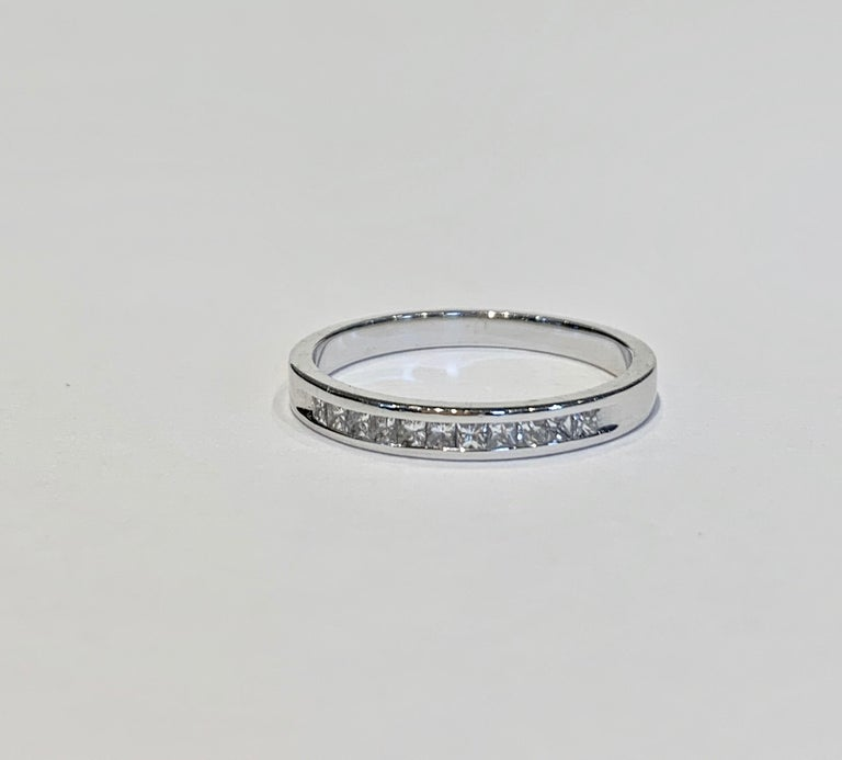 This elegant and classic channel set Eternity Band can be used also as a Wedding Band, an Eternity Band or simply stack alongside other rings on either the left hand or right hand.  The Eternity band has 11 Princess Cut diamonds, G/H in colour and