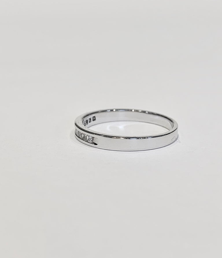 Modern .50 Carat Princess Cut Diamonds Channel Set Eternity Band in 18 Carat White Gold For Sale