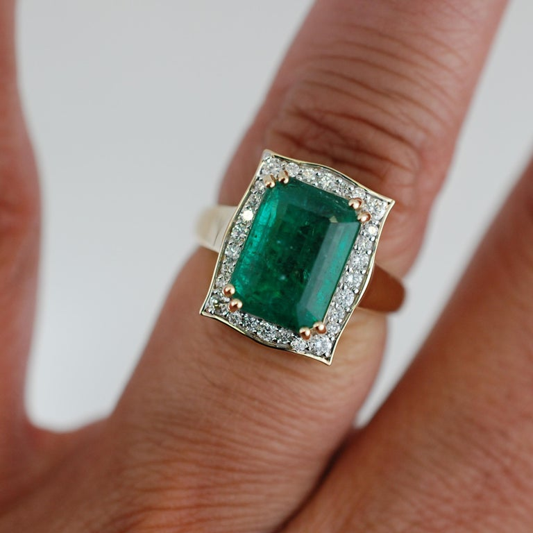 This stunning emerald and diamond ring contains the following.  One octagonal cut emerald set in a 8 prong setting.  The center stone measures 8.1 x 11.26 x 6.51mm.  The center stone has a even green color and good clarity.  The ring has over .30