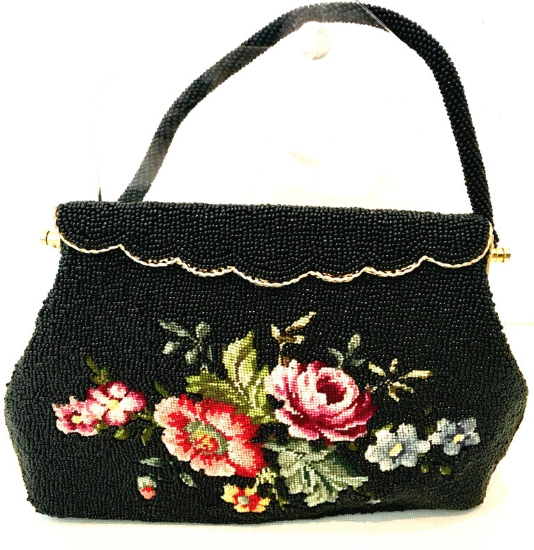 1950'S Hand Beaded & Crewel Embroidered Hong Kong Evening Bag. This pristine and unique piece is executed with jet black art glass beads, and and a crewel embroidered central floral motif. The rope style handle strap is also made of jet black art