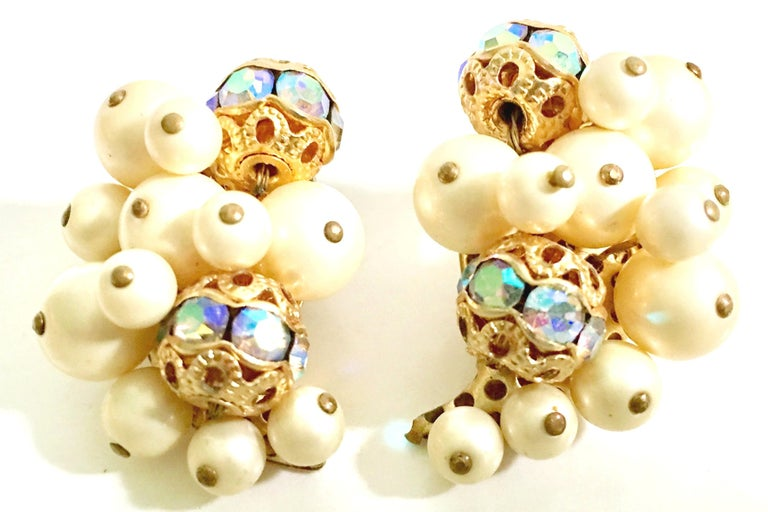 1950'S Gold Gilt abstract leaf shape articulating faux pearl and aurora borealis Swarovski crystal bead earrings by, Kramer. There is a specific right and left earring to this pair.. Each piece is signed on the underside, Kramer.