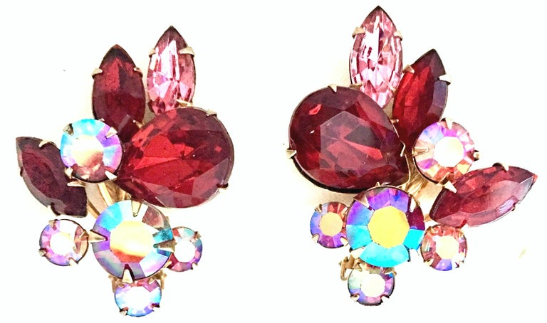 1950'S Gold Plate & Swarovski Crystal Rhinestone Earrings By, Beaujewels. These brilliant and dimensional prong set abstract earrings feature, ruby, pink and aurora borealis crystal rhinestones. This clip style pair of earrings are designed with a