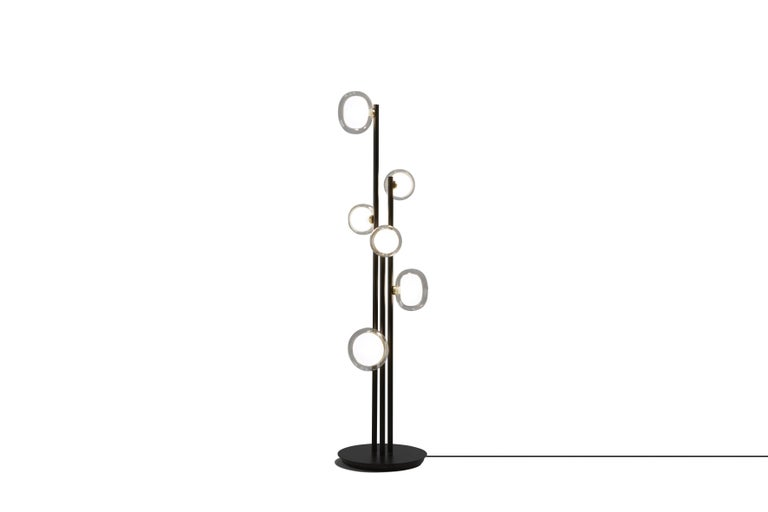 1950 Inspired collection of elegant and sophisticated lamps representing the detail to enrich any location. A double-sided spherical bright object in borosilicate glass makes these lamps available in different compositions and a structure made by