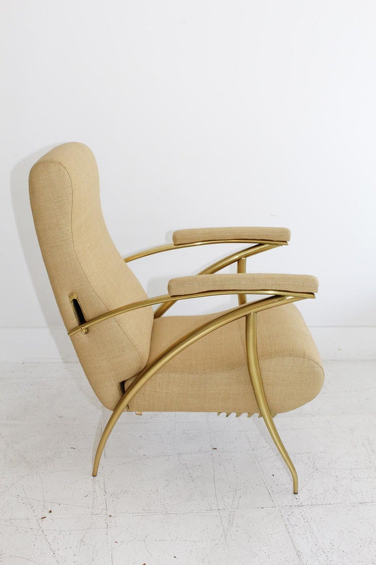 Our rare fully restored circa 1957 Italian reclining chair designed by Alberto Gambetta has a polished brass frame, wheat-colored woven silk upholstery, and four adjustable settings.