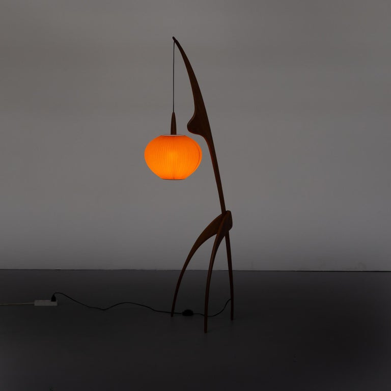 This iconic and graphic 'praying mantis' floor Lamp was realized by the esteemed French designer Jean Rispal circa 1950 though it is never confirmed that Jean really made the design. In official Rispal historical documents it is mentioned that the