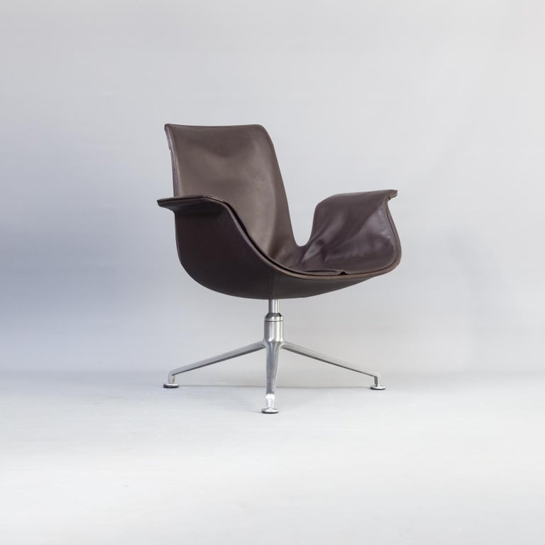 1950s Jørgen Kastholm & Preben Fabricius 6727 Tulip lounge chair for Knoll. The FK6727 tulip chair was introduced in 1964. As revolutionary design of a swivel armchair the chair received the federal prize for good form. Natural tulip form combined