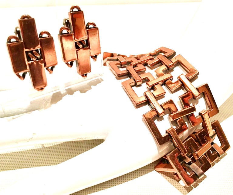 1950'S Matisse Renoir copper modernist geometric chain link bracelet and earring, three piece set. What makes these Mid-Century Era designed pieces current today is the
