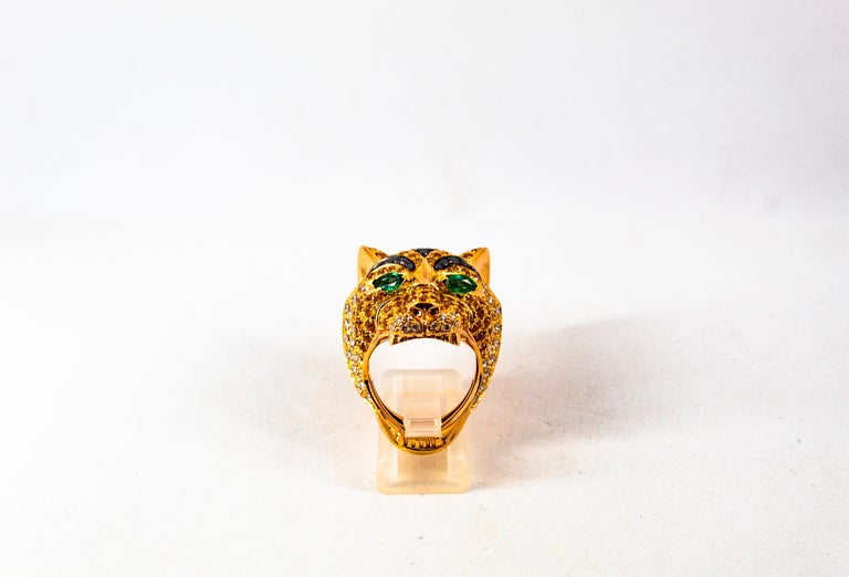 This Ring is made of 14K Yellow Gold. This Ring has 1.10 Carats of White Diamonds. This Ring has 0.40 Carats of Black Diamonds. This Ring has 0.40 Carats of Emeralds. This Ring has 5.00 Carats of Yellow Sapphires. Size ITA: 16 USA: 7 1/2 We're a