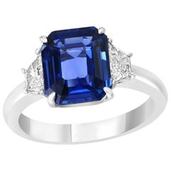 5.11 Carat Emerald Cut Sapphire with Two Accent Diamonds Totaling .52 Carat