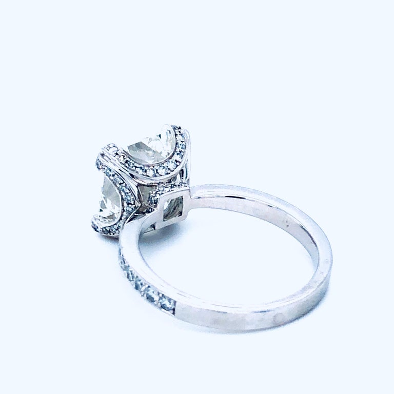 Offered here is an elegant radiant cut diamond engagement ring set in platinum.  Diamond: natural 5.11 radiant cut diamond  Gia cert# 16226237 color:H clarity: VVs1 Measurements: 10.27 x 9.55 x 6.10 mm depth: 63.9% table: 72% Girdle: extremely thin