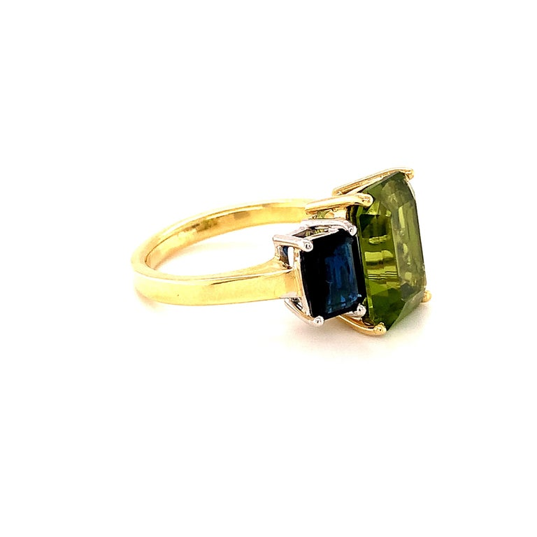 Emerald Cut 5.12 Carat Peridot and Sapphire White and Yellow Gold 3-Stone Cocktail Ring For Sale
