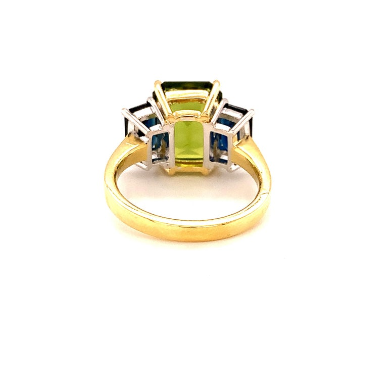 Women's 5.12 Carat Peridot and Sapphire White and Yellow Gold 3-Stone Cocktail Ring For Sale