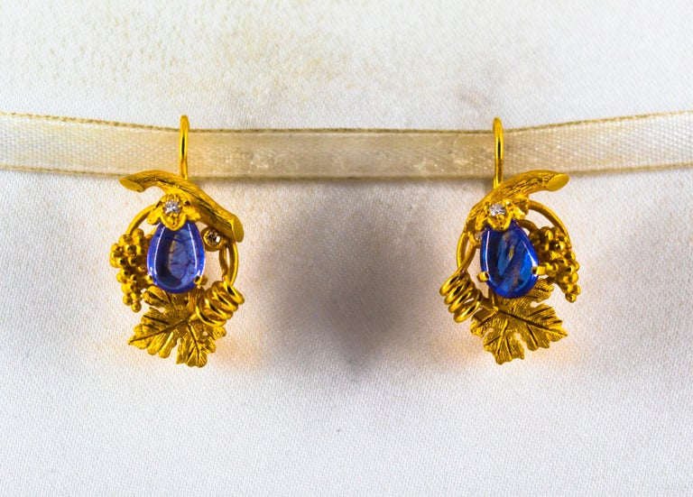 These Earrings are made of 14K Yellow Gold. These Earrings have 0.12 Carats of White Diamonds. These Earrings have 5.00 Carats of Tanzanite. These Earrings are inspired by Art Nouveau. All our Earrings have pins for pierced ears but we can change