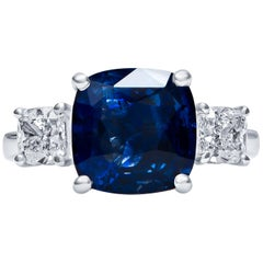 5.13 Carat Cushion Cut Blue Sapphire and 1.10 Carat Diamond, 3-Stone Ring
