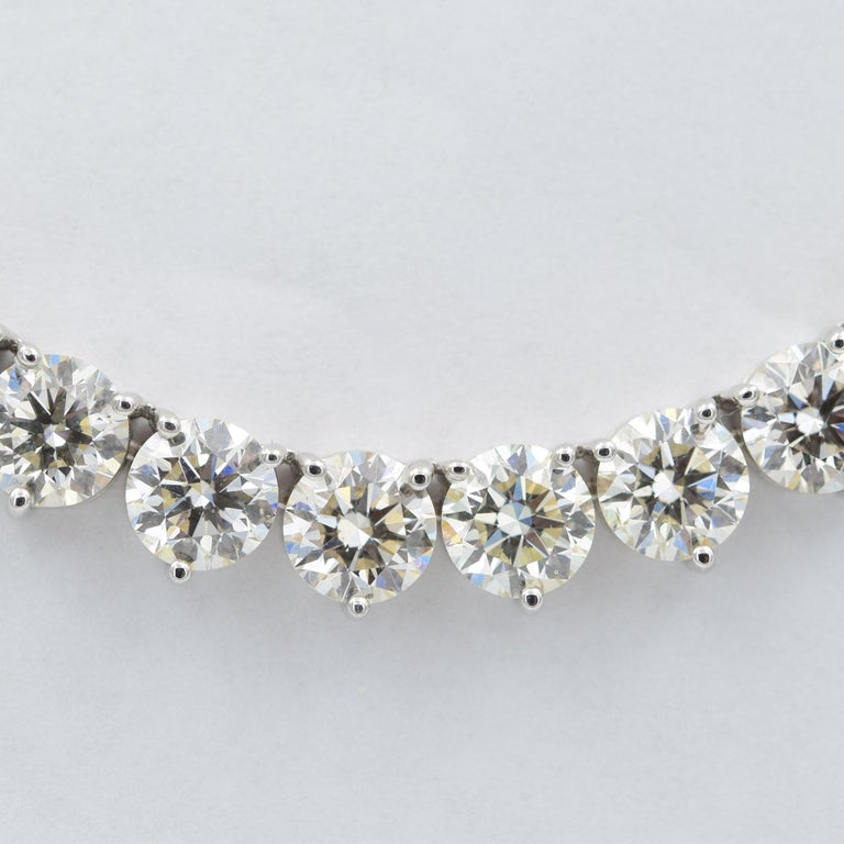This diamond riviera necklace is absolutely stunning. It contains 52.07 carats of round brilliant cut diamonds! Crafted in 18k white gold, this riviera contains high-quality white diamonds which have been matched with I-J in color and VS clarity.