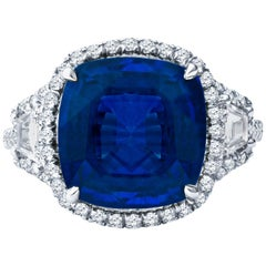 5.21ct Blue Sapphire w 0.29ctw Step Cut Trapezoid and 0.51ctw Round Diamond Ring