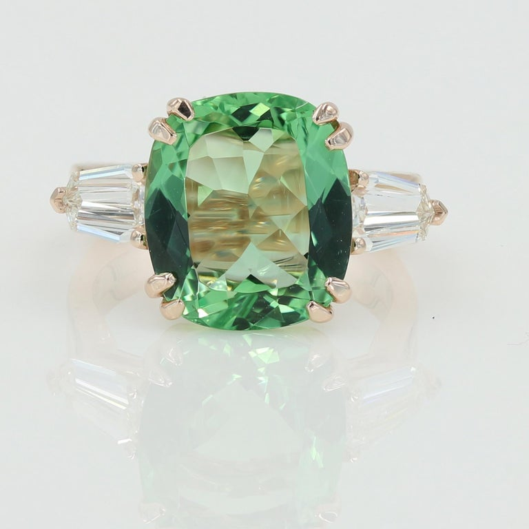 Natural cushion cut Green Beryl weighing 5.22cts set in a Lester Lampert original 14kt Rose Gold mounting with 2 shield cut diamonds weighing 0.84ctw. (F-G VS)