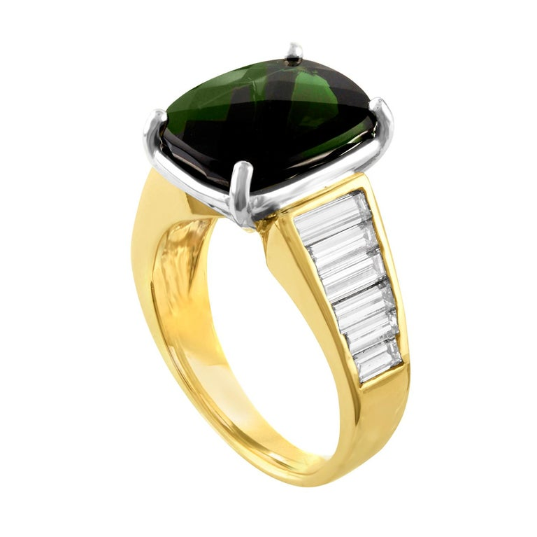 Beautiful Cocktail Ring The ring is 14K White & Yellow Gold The center stone is 5.23 Carats Cushion Green Tourmaline There are 1.25 Carats In Baguette Diamonds F VS The ring is a size 5.5, sizable. The ring weighs 6.4 grams