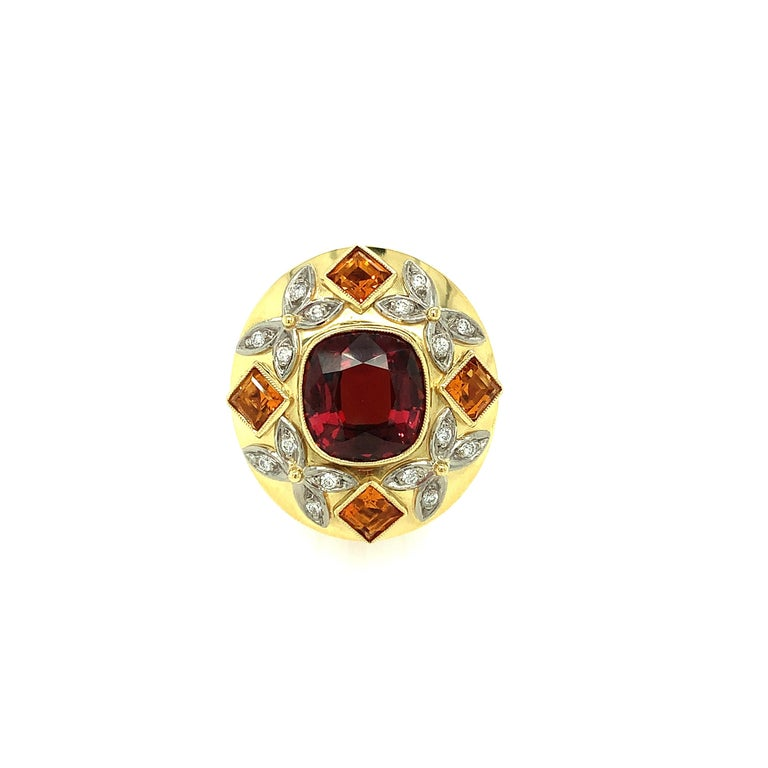 A fiery, orange-red spinel is set in this beautiful 18k yellow, rose and white gold handmade ring. The design is inspired by all things regal and is perfect for someone who is ready to make a statement! Square faceted citrines set in yellow gold