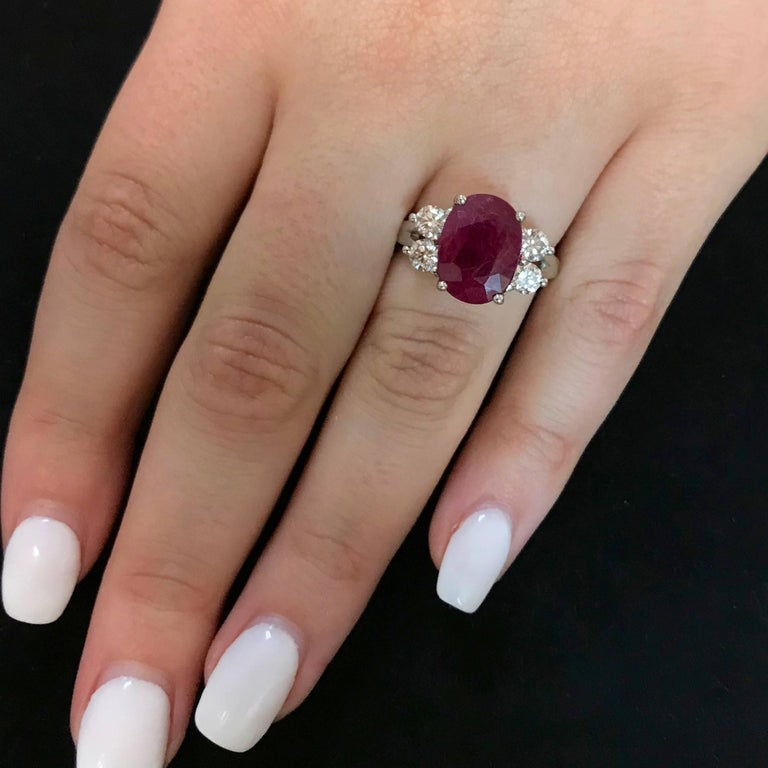 Contemporary Oval Ruby and Diamond Side Stone Engagement Ring