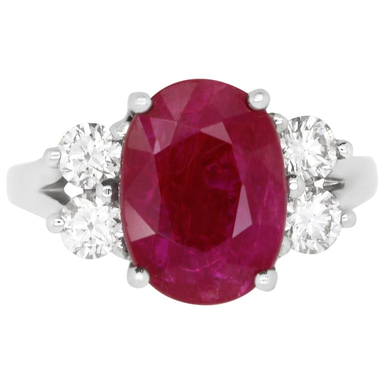 Oval Ruby and Diamond Side Stone Engagement Ring