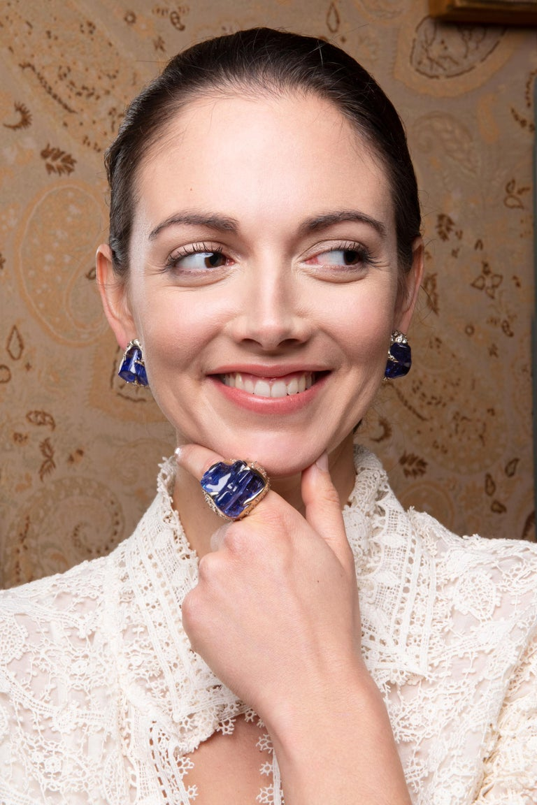 Gross weight: 34.180 grams  Gold weight: 24.100 grams  Tanzanite: 52.580 carats  Diamonds: 3.220 carats   Matching statement ring also available.  Glam rocks can be ordered in other precious stones.  Superb tumbled and polished tanzanite in reverse