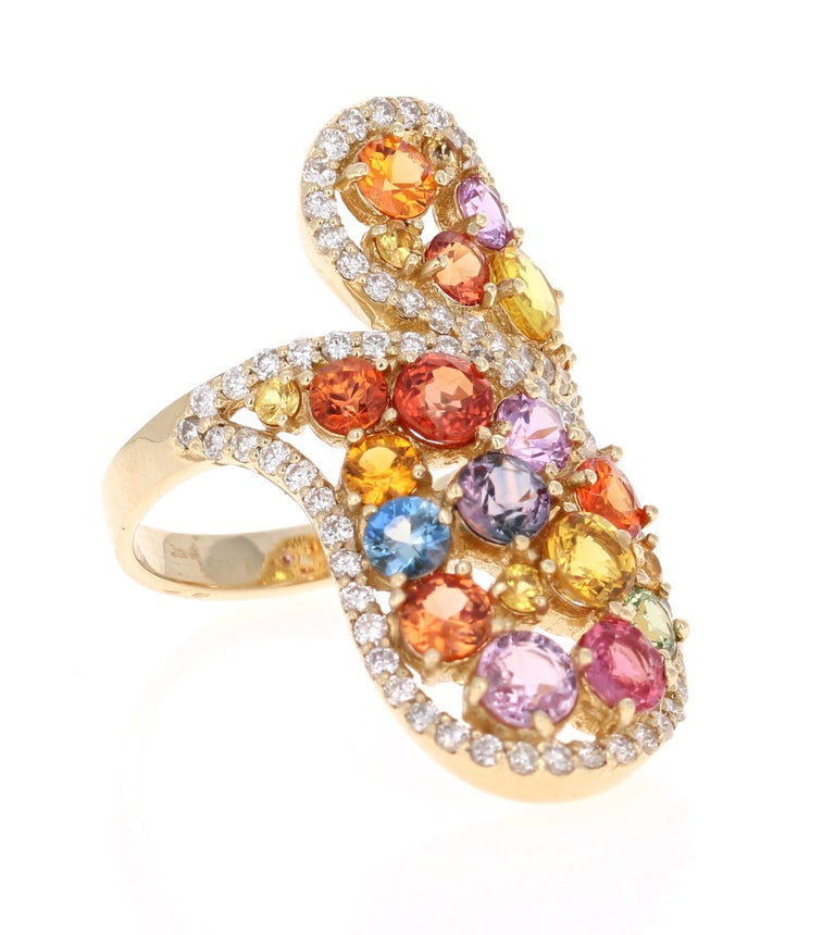 Super gorgeous and uniquely designed 5.27 Carat Multi-Colored Sapphire and Diamond 14K Yellow Gold Cocktail Ring!  This ring has a cluster of 22 Round Cut Multi-Colored Sapphires that weigh 4.47 carats and 73 Round Cut Diamonds that weigh 0.80
