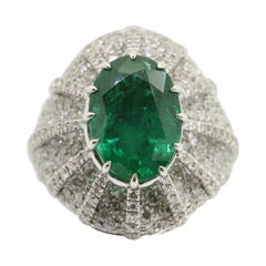 5.28 Carat Oval Emerald and 2.40 Carat White Diamonds Cocktail Ring