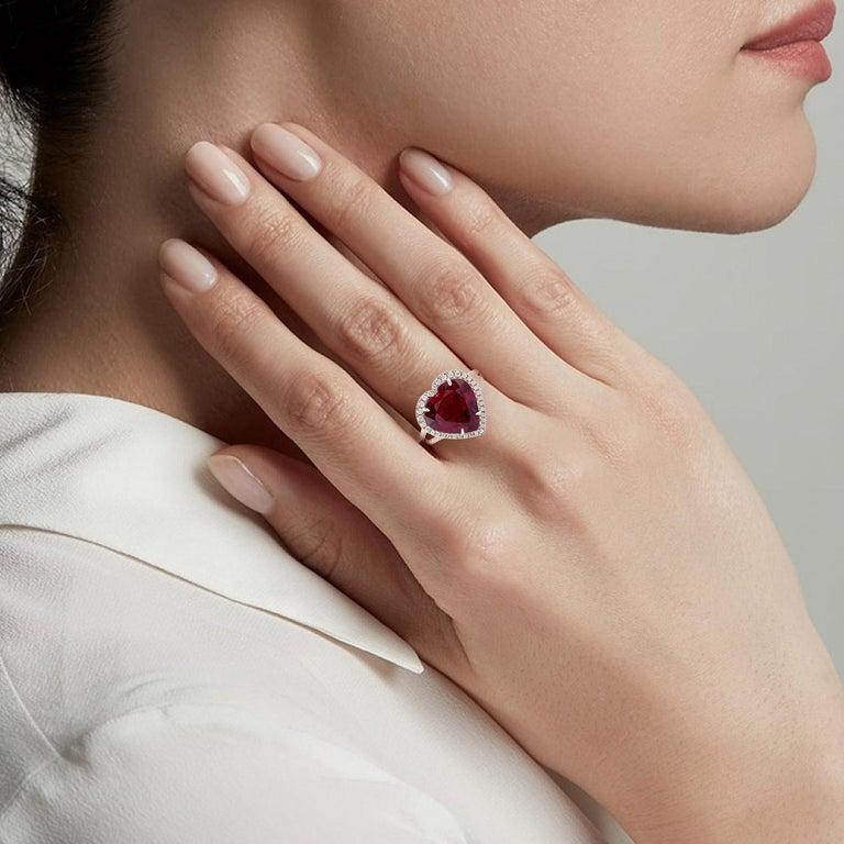 This ring has been meticulously crafted from 18-karat gold.  It is hand set with 5.85 carat rubellite & .53 carats of sparkling diamonds.   The ring is a size 7 and may be resized to larger or smaller upon request.  FOLLOW  MEGHNA JEWELS storefront
