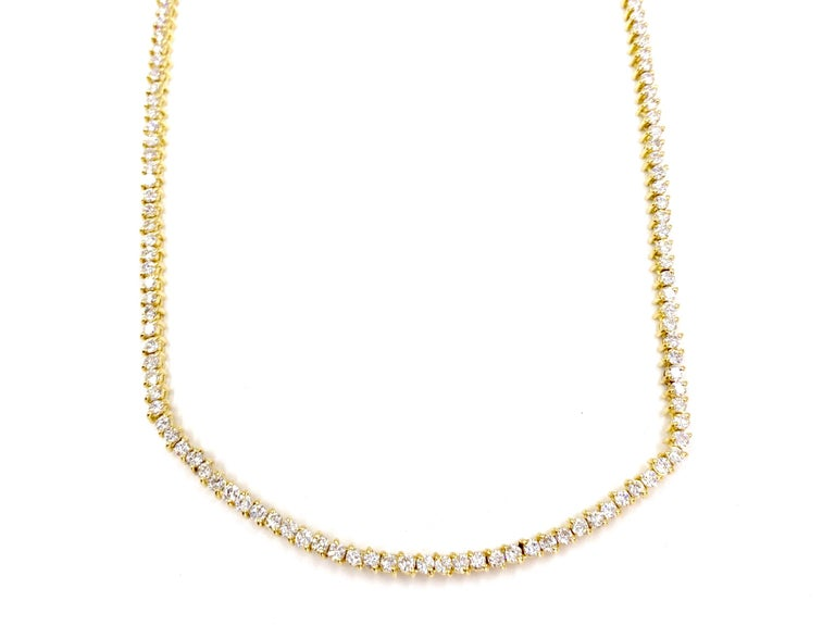 The perfect every day diamond tennis necklace featuring 189 round brilliant diamonds at 5.30 carats total weight beautifully prong set in 18 karat yellow gold. Diamond quality is approximately F-G color, VS1 clarity. Necklace is designed with the