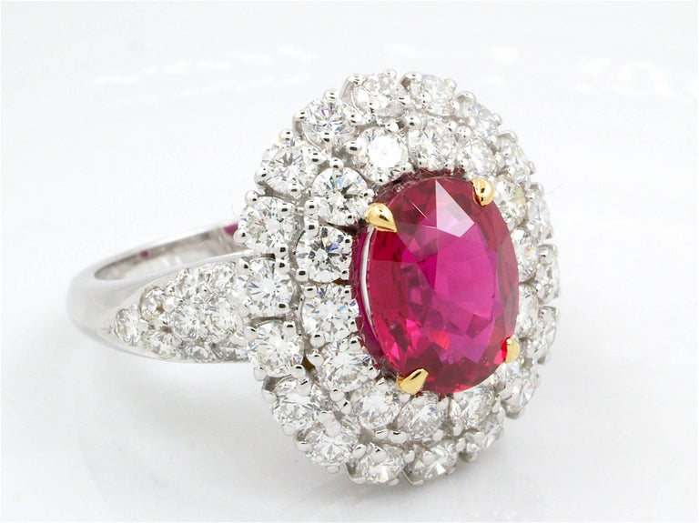 This beautiful ring is accompanied by a magnificent natural ruby ​​with an excellent quality weighting  3.06 carats.  Diamonds surrounded the main stone and placed on the frame for a total weight of 2.25 carats, clarity VVS and color F.  The