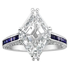 5.31 Carat I VS1 Lozenge Stepcut Diamond and Calibre Sapphire Ring by Hancocks