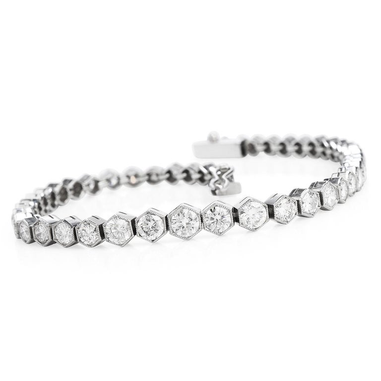 Crafted in solid Platinum, the incredible sparkle onthis Diamond braceletcomes from its49Genuine Round cut Diamonds with a total carat weightof 5.34cts, G-H color, VS1-VS2 clarity, all prong set. The Modern touch on this piececomes fromthe