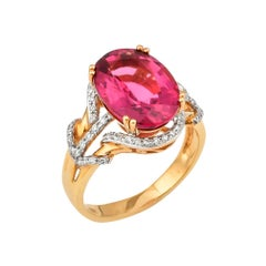 5.35 Carat Oval Shaped Rubelite Ring in 18 Karat Yellow Gold with Diamonds