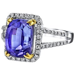5.35 Carat Tanzanite and Diamonds 18 Karat White Gold Halo Ring