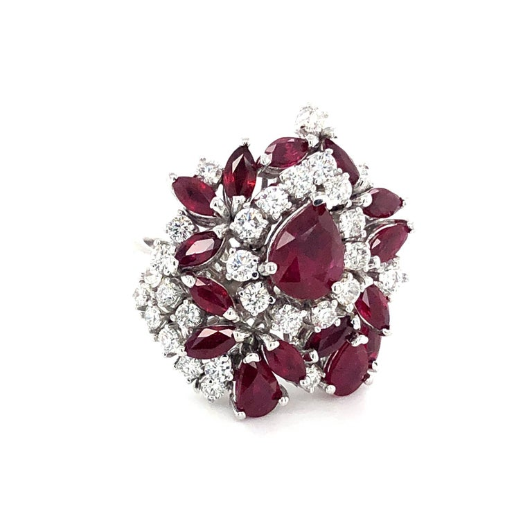 Offered here is a beautiful ladies ruby and diamond cocktail ring set in 18kt white gold . The ring is a finger size 7 that can be sized. The ring has sixteen ( 16 ) natural rubies three ( 3 ) pear shape and thirteen ( 13 ) Marquise cut. The rubies
