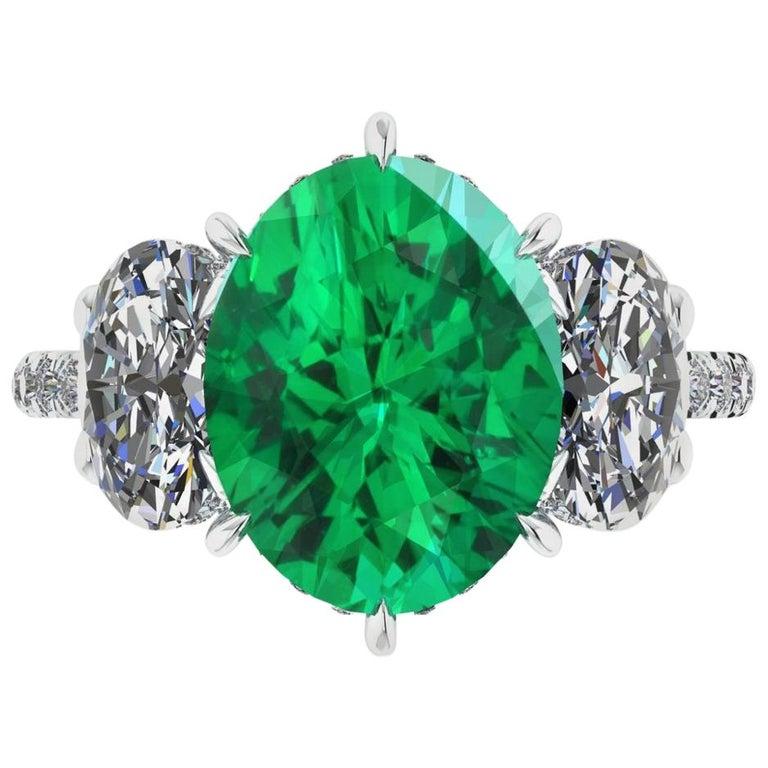 5.37 Carat Oval Emerald 2 Carat Oval White Diamonds Platinum 950 Ring For Sale