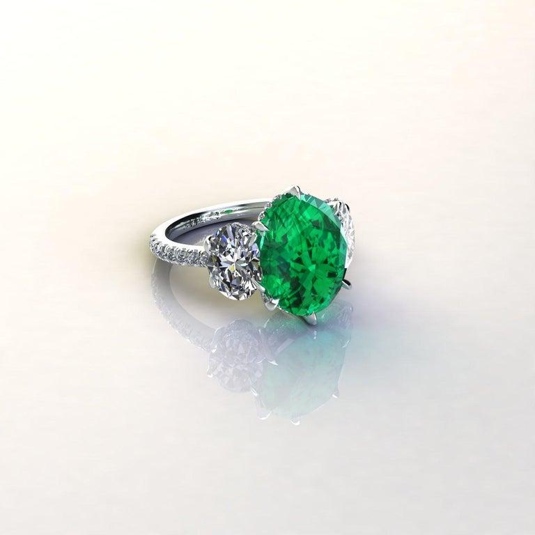 Contemporary 5.37 Carat Oval Emerald 2 Carat Oval White Diamonds Platinum 950 Ring For Sale