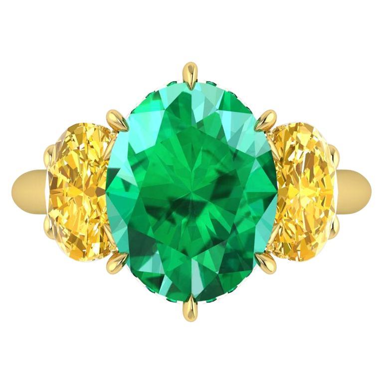 5.37 Carat Oval Emerald Oval Yellow Vivid Diamonds 18 Karat Gold Ring