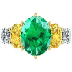 5.37 Carat Oval Emerald Yellow and White Oval Diamonds Platinum 18k Gold Ring