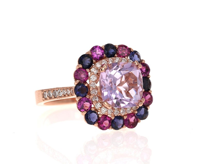Amethyst, Purple Garnet and Diamond Cocktail Ring!   A beautiful and sparkly combination of Purple beauty!  This one of a kind piece has been carefully designed and curated by our in house designer!  This ring has a light purple Cushion Cut Amethyst