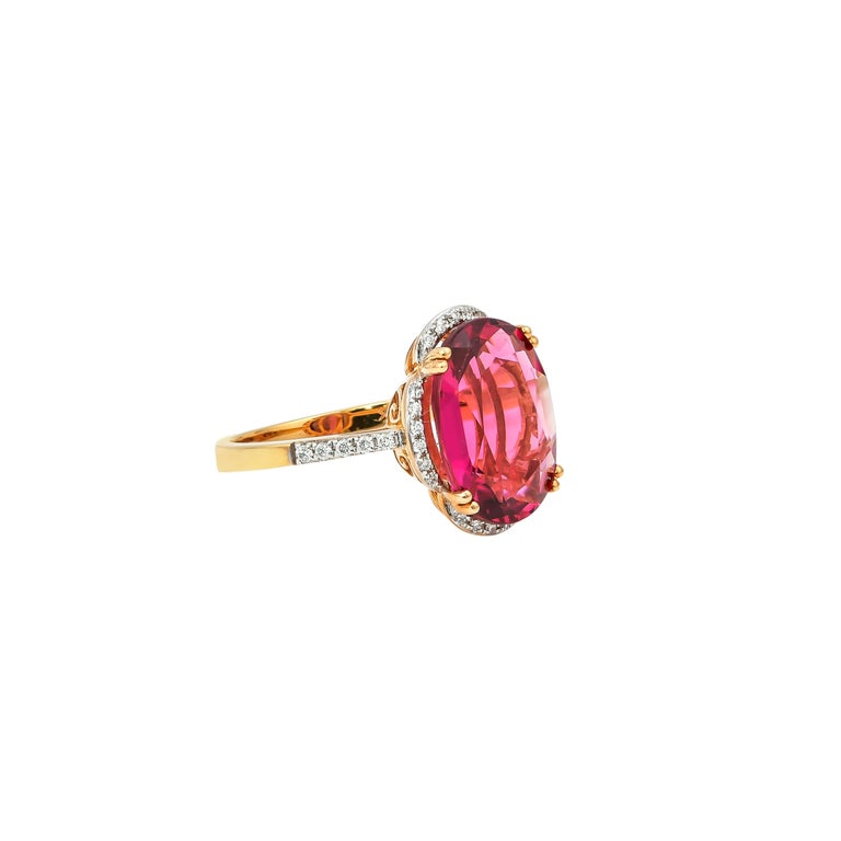 Contemporary 5.42 Carat Oval Shaped Rubelite Ring in 18 Karat Yellow Gold with Diamonds For Sale