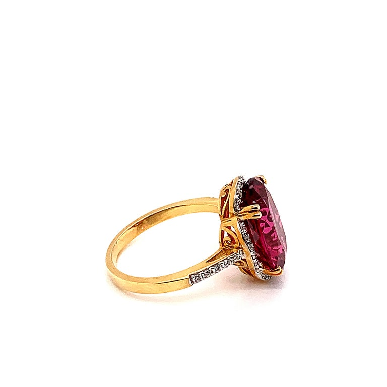 Oval Cut 5.42 Carat Oval Shaped Rubelite Ring in 18 Karat Yellow Gold with Diamonds For Sale