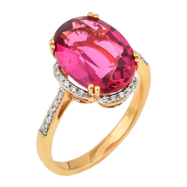 5.42 Carat Oval Shaped Rubelite Ring in 18 Karat Yellow Gold with Diamonds For Sale