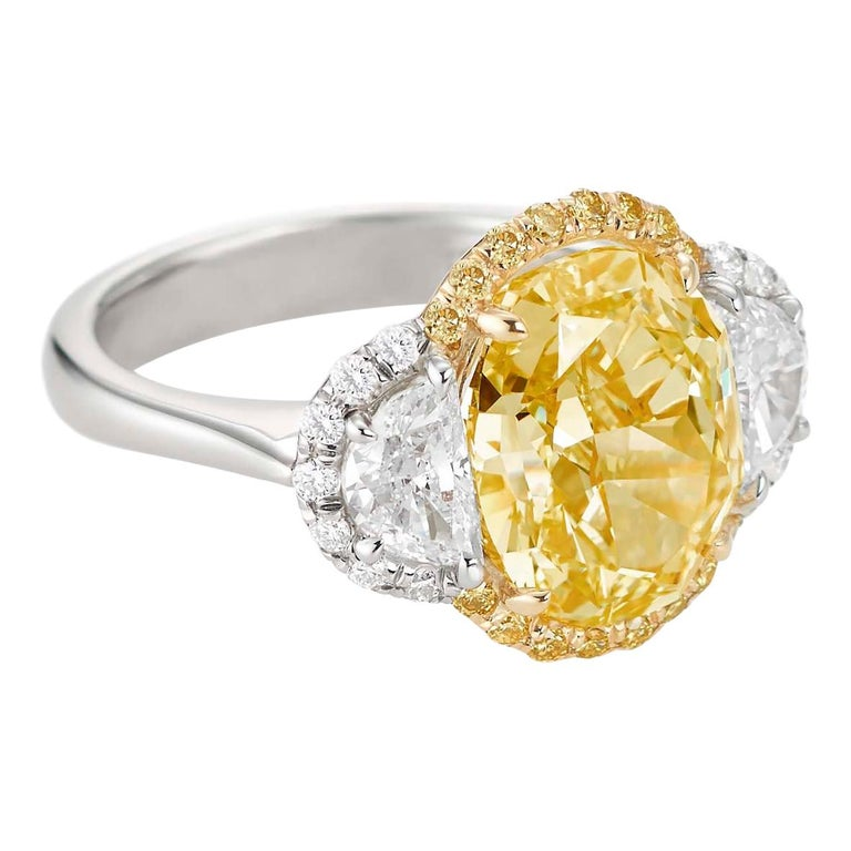 5.44 Carat Fancy Yellow Diamond Three-Stone Ring For Sale