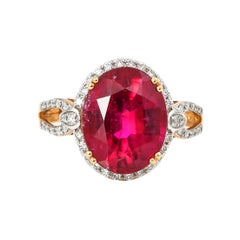 5.46 Carat Oval Shaped Rubelite Ring in 18 Karat Yellow Gold with Diamonds