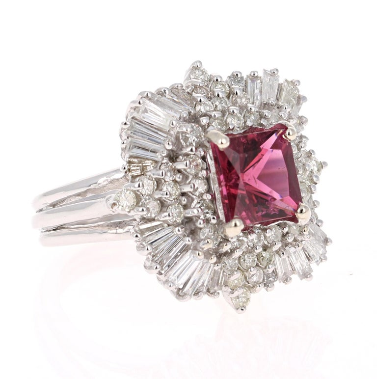 The most beautiful Ballerina ring to be designed! Truly a collectors item!   This ring has a square cut 3.06 Carat Tourmaline and is surrounded by 28 Baguette Cut Diamonds that weigh 1.42 Carats and 40 Round Cut Diamonds that weigh 1.00 Carat. The