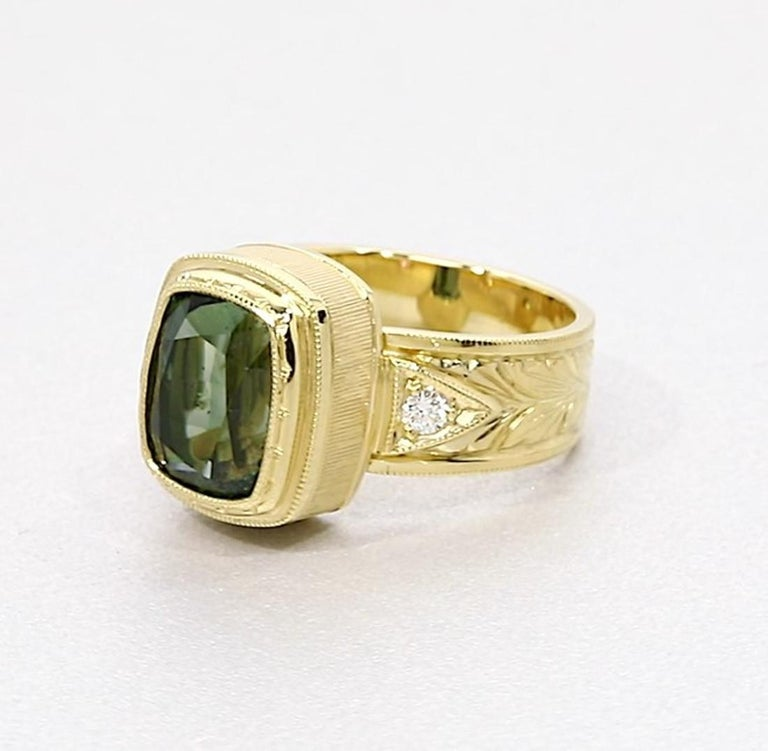Cushion Cut 5.49 ct. Green Tourmaline, Diamond, Yellow Gold Bezel Engraved Band Ring For Sale