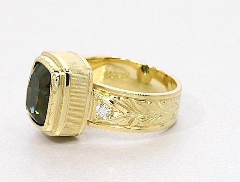 Artisan 5.49 ct. Green Tourmaline, Diamond, Yellow Gold Bezel Engraved Band Ring For Sale